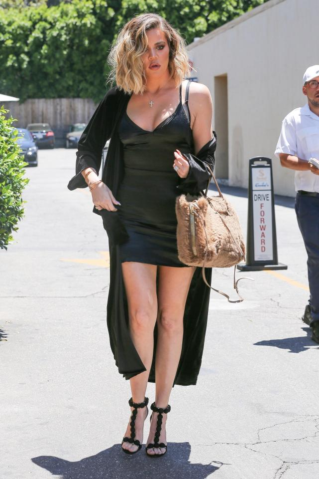 0d119ecda2f026f9283a3d049e701ce1 Khloe Kardashian shows off her slender legs in a busty black minidress