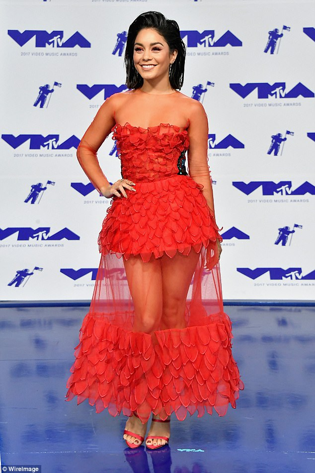 39665d4f469e2e0d52239f1716e22e15 Sizzling in scarlet! Vanessa Hudgens shows some skin in a dramatic sheer red dress at the MTV VMAs