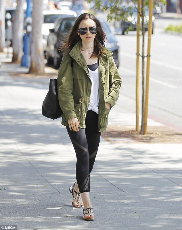 b6ac09b206d2d2d0cea3acc10e3ed684 Fresh-faced Lily Collins flashes a hint of flesh in skin-tight sheer panelled leggings as she nails effortless chic during Beverly Hills stroll