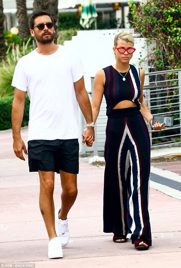 1b407918cc07ca5264d84a6895136000 Scott Disick, 34, and Sofia Richie, 19, hold hands in Miami.... hours after confirming romance with passionate smooch and a 'congratulations' cake