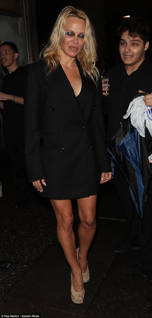 34a0f94edf9c7f4a0720b07c59fcd51a Been on Beer-watch? Bleary-eyed Pamela Anderson, 50, looks all partied out in leg-flashing LBD as she leaves a club after New York Fashion Week show