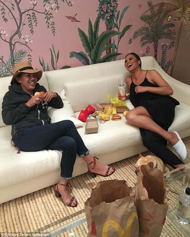 3c723a412f9ae98a4e9a7d48bad64ea4 Did somebody say McDonald's? Chrissy Teigen indulges in hamburgers and french fries during girls' night in with her mother Vilailuck
