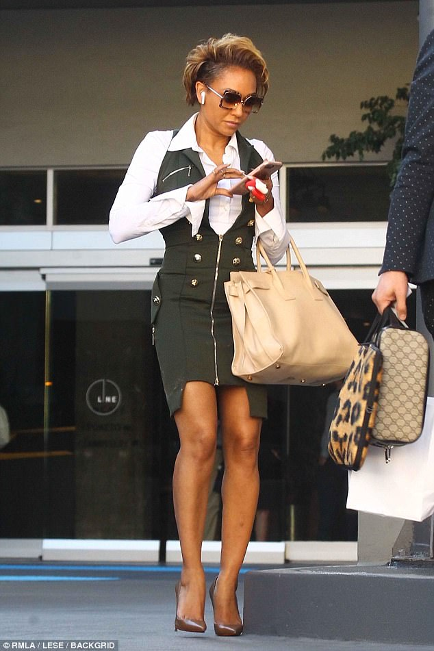 6fda8fbe60ea4be936f42c034e7efc85 Mel B power dresses for a court visit in Los Angeles amid claim her estranged husband Stephen Belafonte has been 'sleeping on a friend's couch and can only visit their daughter under supervision'