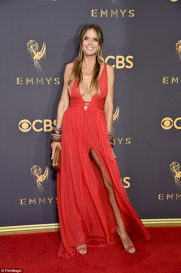 976d32ae27f97207a996bbe5012baa89 Newly-single Heidi Klum, 44, shows ex Vito Schnabel, 31, what he's missing as she flashes her cleavage in a plunging red gown at the Emmys