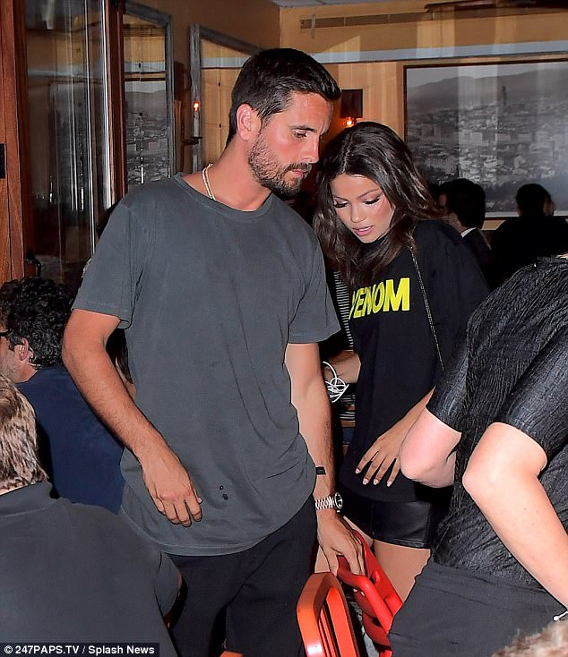 9ef878813a45ce4a4dc791db6026ff9e Looks familiar! Scott Disick out with brunette who bears uncanny resemblance to Kourtney Kardashian after being 'placed in psychiatric hold'