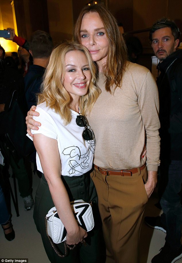 4b3cf3e0b86da00c794c0748531b74d4 Can't get you near to my head! Petite Kylie Minogue, 49, looks chic in high-waisted trousers as 5ft4 Stella McCartney towers over her at Paris Fashion Week