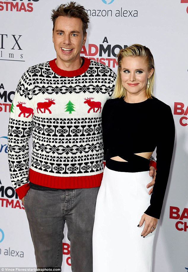 aecf2fd74a250ff30e8f4016c801644b No mistletoe necessary! Kristen Bell kisses hubby Dax Shepard at the premiere of Bad Mom's Christmas
