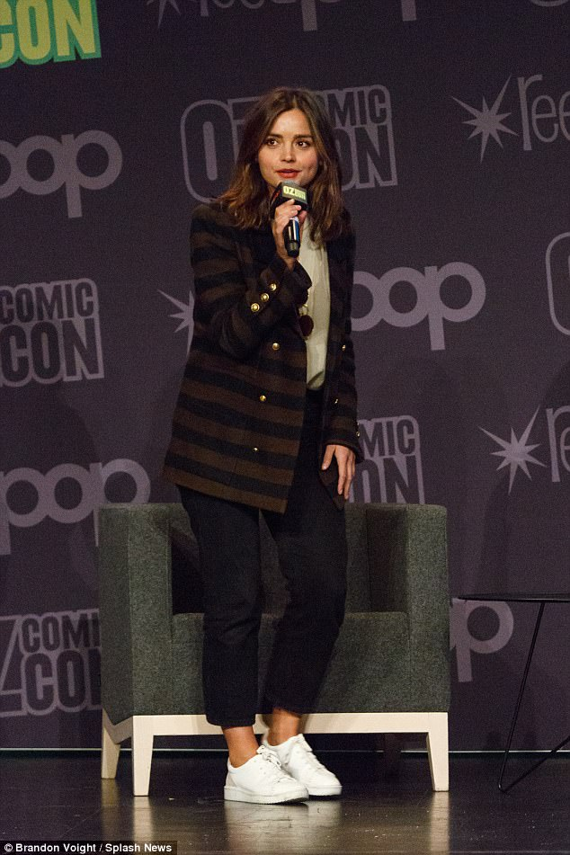 b90205c2732bf156df1e964c8796b343 Queen of the small screen! Victoria's Jenna Coleman swaps her regal gowns for a chic cream blouse and striped blazer at Comic-Con in Sydney