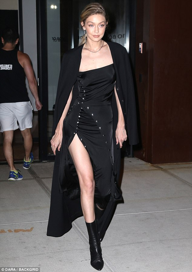 d21893104d68e60e721446f5f80cb92b Getting a leg up! Gigi Hadid flashes a glimpse of her toned thighs in racy split gown as she steps out in NYC