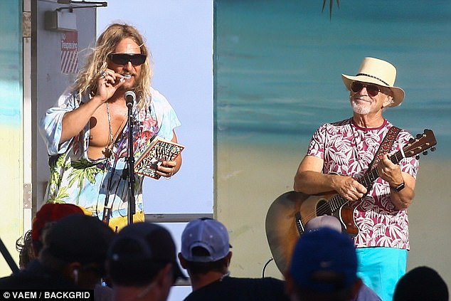 316761511bf60343f06ed5c9b45bf3b2 Double trouble! Matthew McConaughey pretends to smoke joint with Jimmy Buffett as he dances on stage while filming The Beach Bum