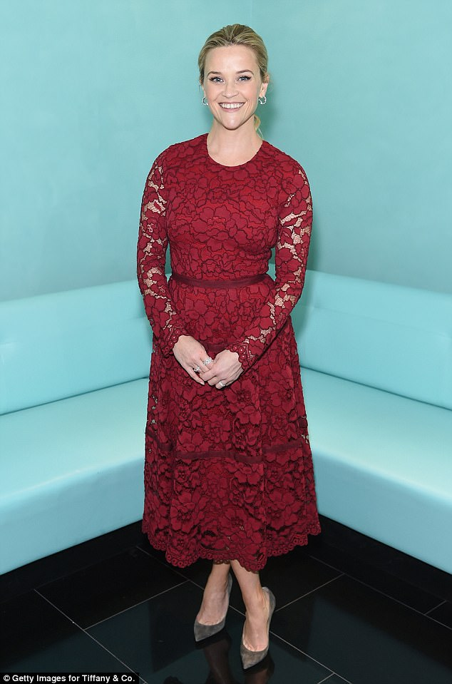 81fbef09f021ebc74ccaf2b7a9a356b8 Breakfast at Tiffany's! Reese Witherspoon looks stunning in a lacy red dress at holiday event in New York
