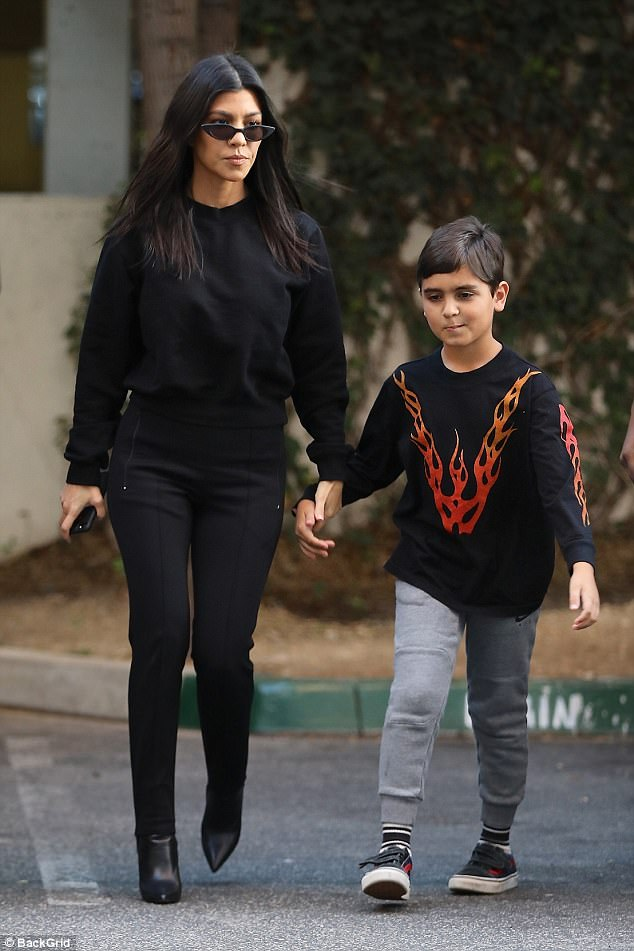 9b5795dd55aa946aab68399526241395 Stylish mom Kourtney Kardashian looks svelte in all-black as she takes son Mason to art class in LA