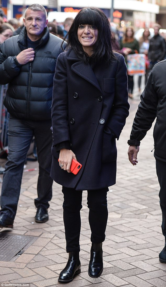 b2272fcef093e4544b76a87ad54e314e Feeling cha-cha-cha chilly? Strictly Come Dancing's Claudia Winkleman wraps up in a black pea coat as she steps out on the streets of Blackpool
