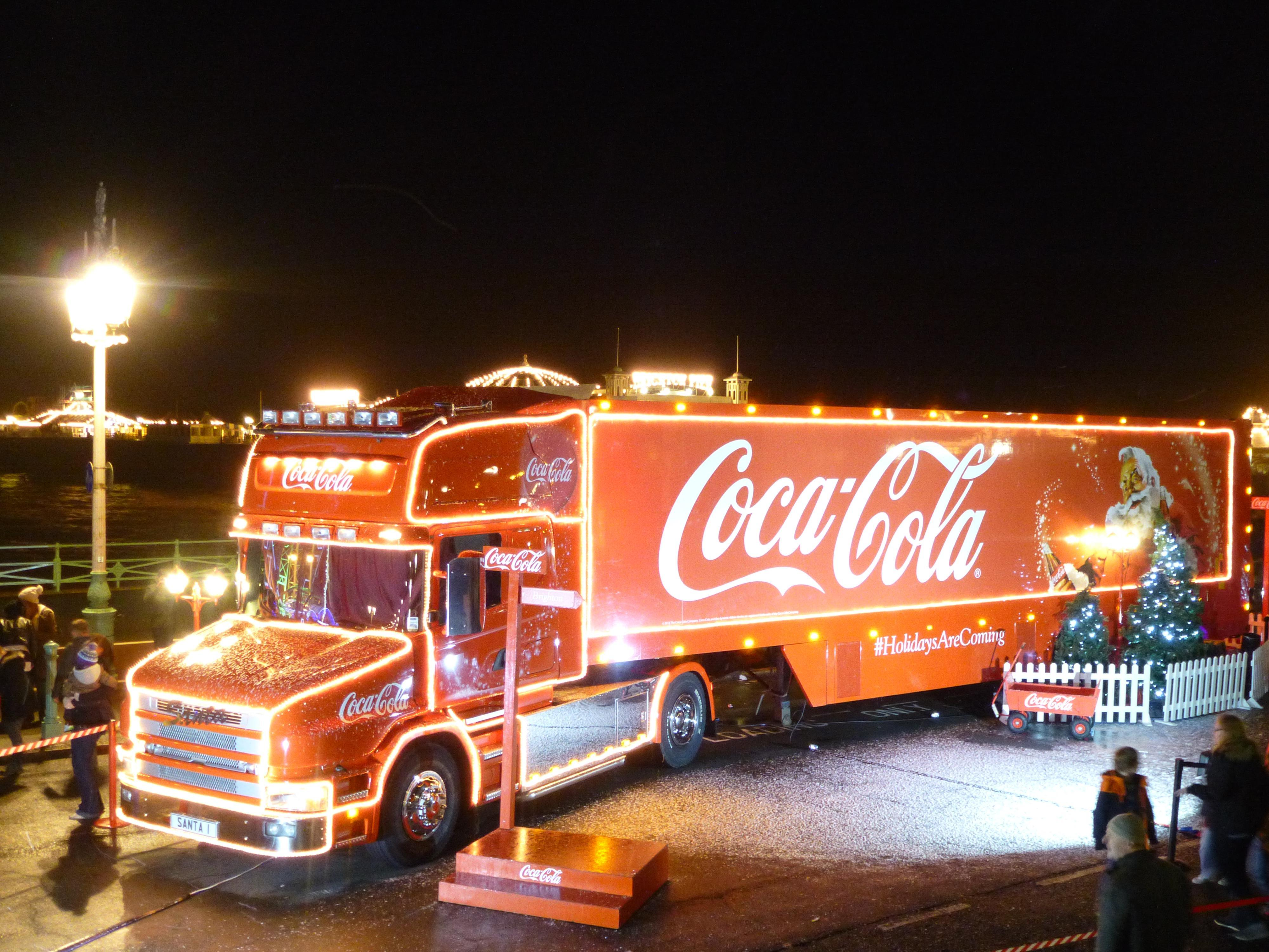 df56f4f82dc6f30bb921ad9c1c8dfd09 Coca-Cola's Christmas truck tour of the UK 'should be BANNED, to help in crackdown on childhood obesity', experts say