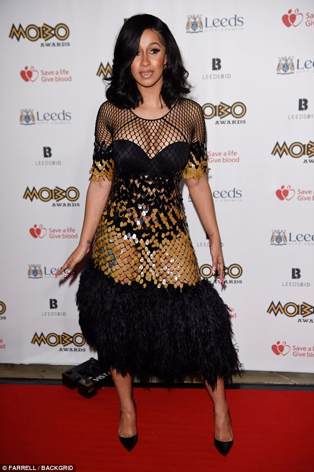 e828c26a6c68b8eb29d45169b555efc1 What a catch! Rapper Cardi B flashes cleavage in fishnets and ruffles at the MOBO Awards