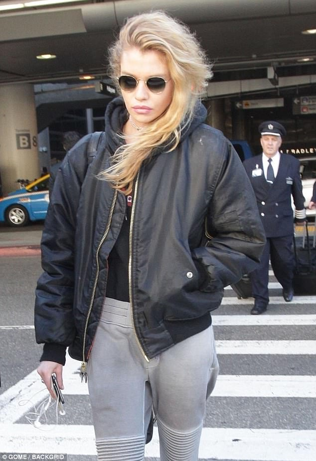 2fe79045a7664b88612345c016949fcf Fashionable flyer! Stella Maxwell dons casual yet chic ensemble featuring grey sweatpants and bomber jacket while arriving at LAX