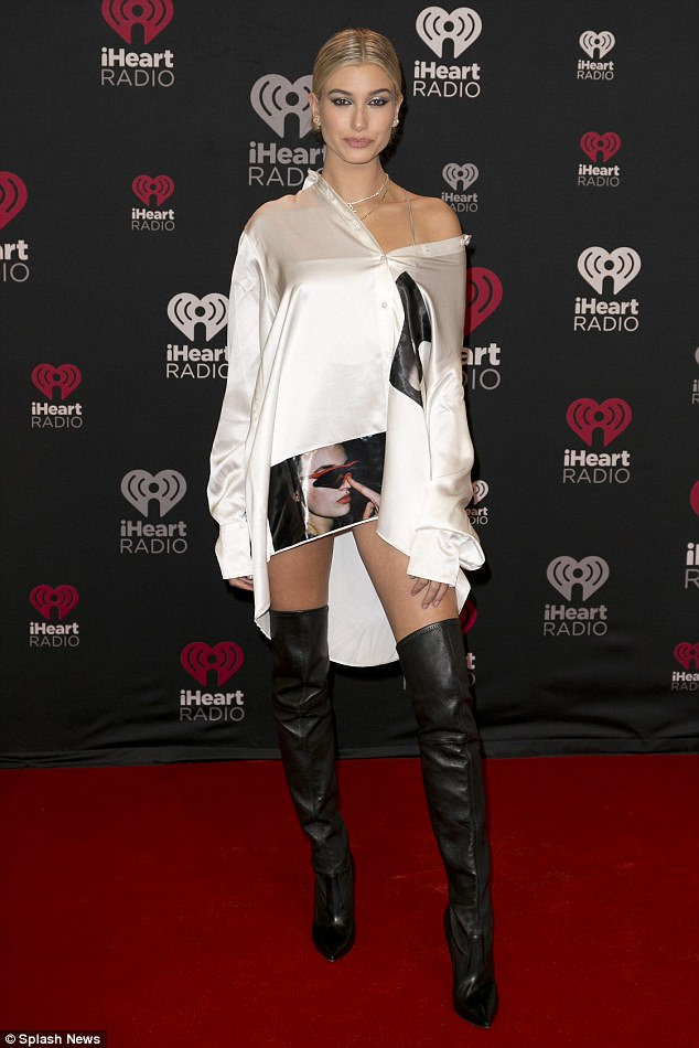 373bdca543e125f22d626c9016d2541d Putting in the leg work! Hailey Baldwin flashes the flesh in thigh-high boots and slinky shirt dress as she leads the stars at Jingle Ball North