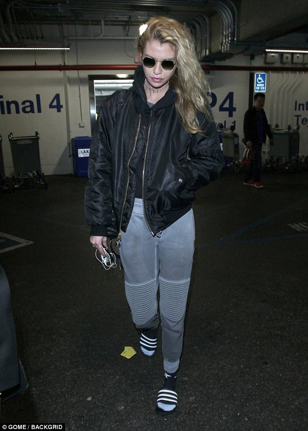 38e3440e00c144289c9f309759b38123 Fashionable flyer! Stella Maxwell dons casual yet chic ensemble featuring grey sweatpants and bomber jacket while arriving at LAX
