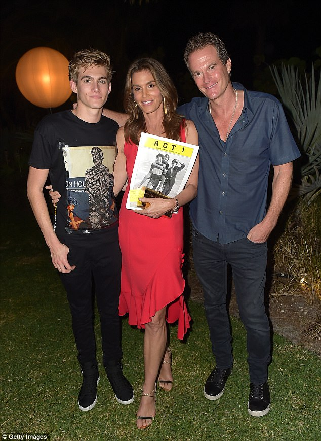 5e5e252604939acbb3f6c9dc9edbef71 Look away, Rande! Cindy Crawford plants an intimate peck on male pal... as she wows in glamorous red frock while partying with her husband and their son Presley Gerber at Art Basel