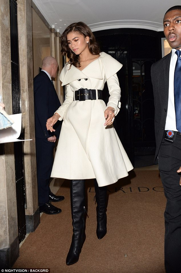 73ee391472c5a9d3d7849a6e369abd76 Zendaya is a wonder in white as she shows off tiny waist in sophisticated jacket dress and thigh-high black boots while greeting fans in London
