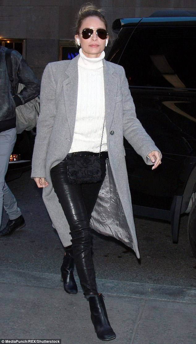 9aa831243af0f6f3f08c6665de9cef3e Hands free! Nicole Richie wears wireless earbuds as she steps out in tight leather pants after TV interview in New York
