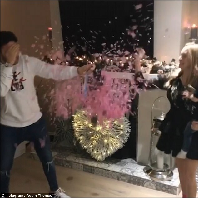 a1ea7852fe5a18fde12f4f10917a2854 'Couldn't be more happier!' Adam Thomas and his wife Caroline welcome cheers of delight from friends and family after divulging they're expecting a GIRL during gender reveal