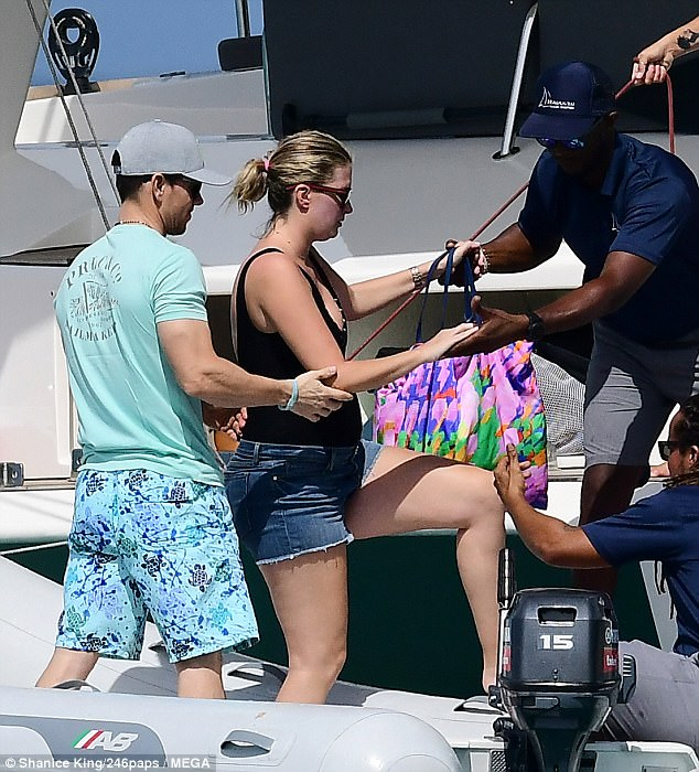 a8d75a184afbbedddb4e94f8a66ed0e3 Yacht a perfect gentleman! Chivalrous Mark Wahlberg gives model wife Rhea Durham a helping hand as she steps onto a boat during Barbados break