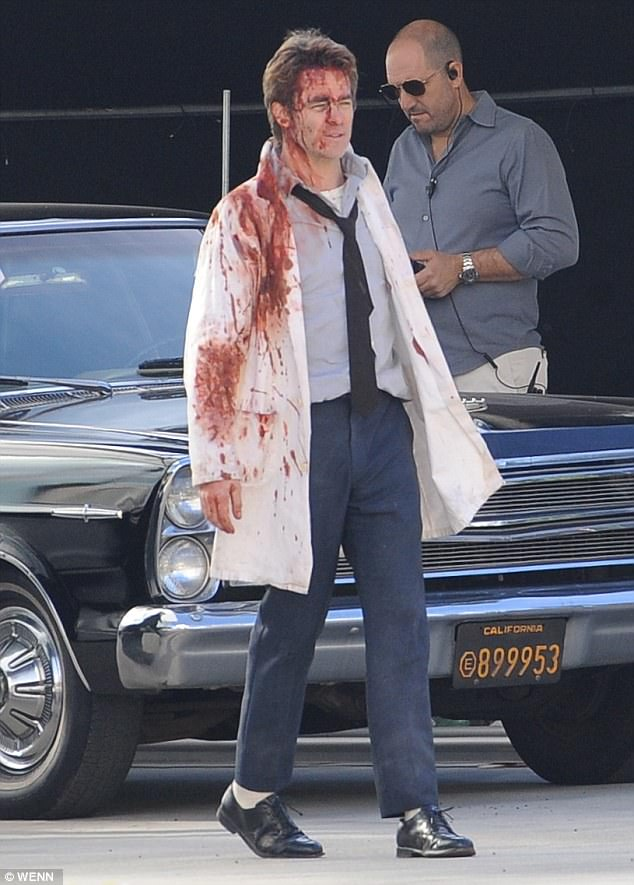 b4efacd3412c594e7c1e61b2fc368d05 Tough day on set! Chris Pine is all bloodied up as he's seen filming TNT mini-series One Day She'll Darken