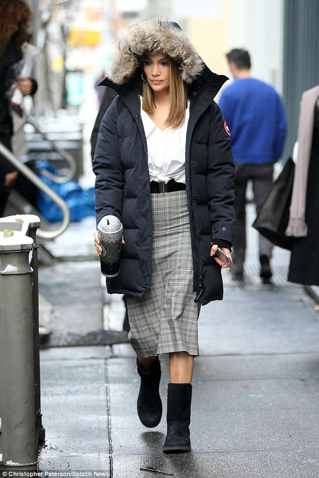 b72d33a83e6e90bb10170cbef2e50eeb Baby, it's cold outside! Jennifer Lopez covers up in a parka and cozy boots as she shoots Second Act in snowy NYC amid rumors of a looming engagement
