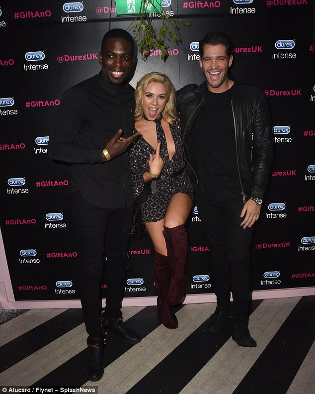 e1e39861754ca9870d1a47f775df1d5b Three's a crowd! Love Island's Gabby Allen threatens to spill out of her low-cut playsuit as she joins beau Marcel Somerville at Durex bash... but newly-single Jonny Mitchell crashes the date
