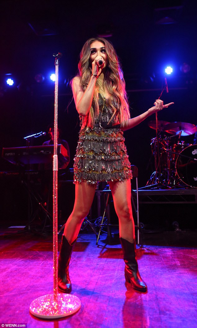 f6776830e85954c372f0bc0d40d2660b Megan McKenna takes to the stage as she puts on another energetic performance in heavily chained minidress at London's Scala club