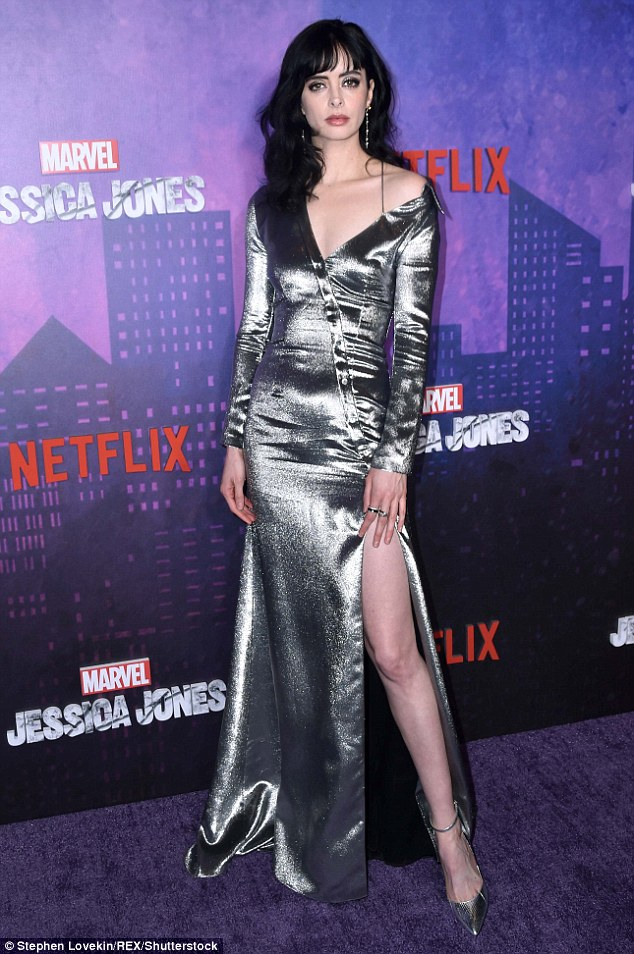 6bc11702cdb543af1c1272f5962e5ee1 Something to Marvel at! Krysten Ritter flashes lots of leg as she dazzles in metallic silver gown at Jessica Jones premiere in New York