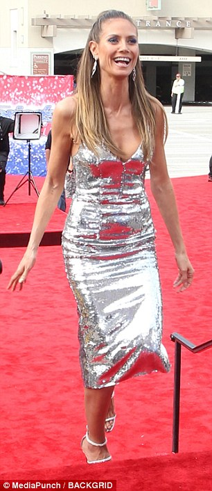 93b93c0126da6bf3734091b582f937f8 All that glitters! Flawless Heidi Klum showcases her fabulous figure in plunging silver gown for America's Got Talent kickoff event in LA