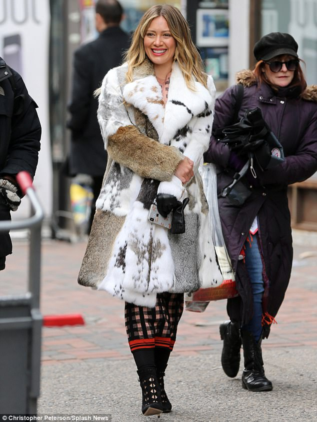 de1cb13ef68c280479dc7aa308411f41 She's fur real! Hilary Duff models multi-colored fuzzy coat while filming her comedy series Younger in New York City